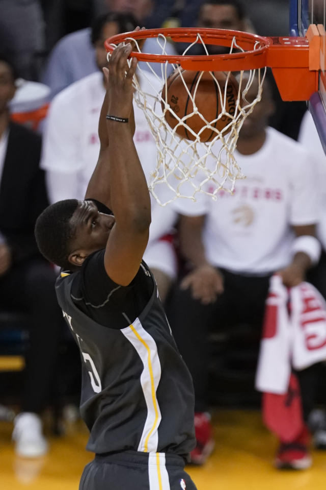 Golden State Warriors center Kevon Looney dunks against the Toronto Raptors during the first half of Game 4 of basketball's NBA Finals in Oakland, Calif., Friday, June 7, 2019. (AP Photo/Tony Avelar)