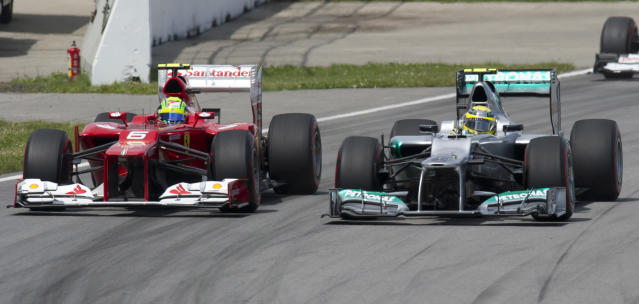 Ferrari driver Felipe Massa (L) of Brazil and Mercedes driver Nico Rosberg of Germany battle for position as they race in the Canadian Formula One Grand Prix on June 10, 2012 at the Circuit Gilles Villeneuve in Montreal. AFP PHOTO/DON EMMERTDON EMMERT/AFP/GettyImages