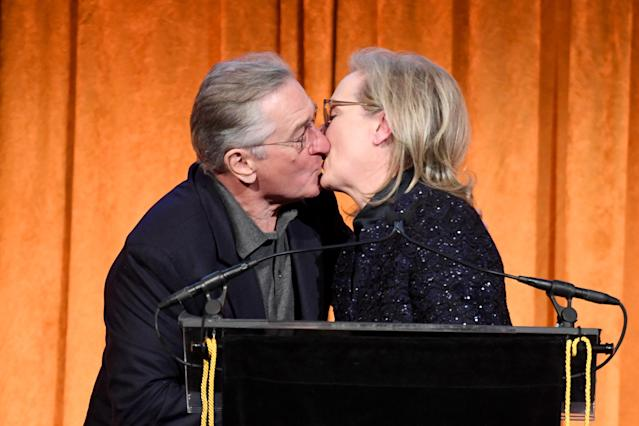 Meryl Streep kissed pal Robert De Niro while accepting an award for Best Actress. (Photo: Getty Images)