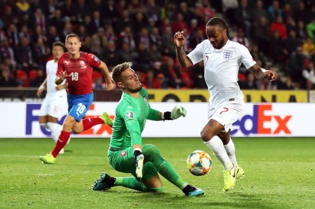 Czech Republic goalkeeper Tomas Vaclik, left, makes a save from England's Raheem Sterling during the UEFA Euro 2020 qualifying, Group A match at Sinobo Stadium, Prague (Nick Potts/PA)