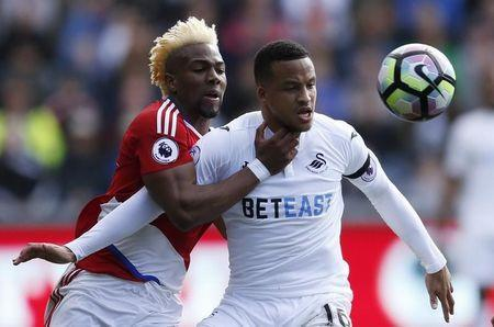 Britain Football Soccer - Swansea City v Middlesbrough - Premier League - Liberty Stadium - 2/4/17 Swansea City's Martin Olsson in action with Middlesbrough's Adama Traore Action Images via Reuters / Andrew Boyers Livepic