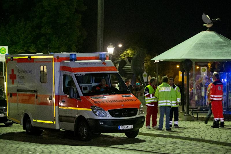 Emergency services pictured near the scene of the attack in Ansbach, southern Germany on July 24, 2016 that left dozens wounded (AFP Photo/Daniel Karmann)