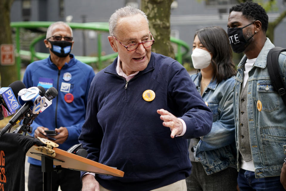 New York Senator Chuck Schumer speaks at a news conference outside an early voting site in New York, Tuesday, Oct. 27, 2020. New Yorkers lined up to vote early for a fourth consecutive day Tuesday after a weekend that saw a crush of more than 400,000 voters statewide. The unofficial tally shows about 194,000 voters this weekend in New York City, where some people waited an hour or more in lines that stretched for several blocks. (AP Photo/Seth Wenig)