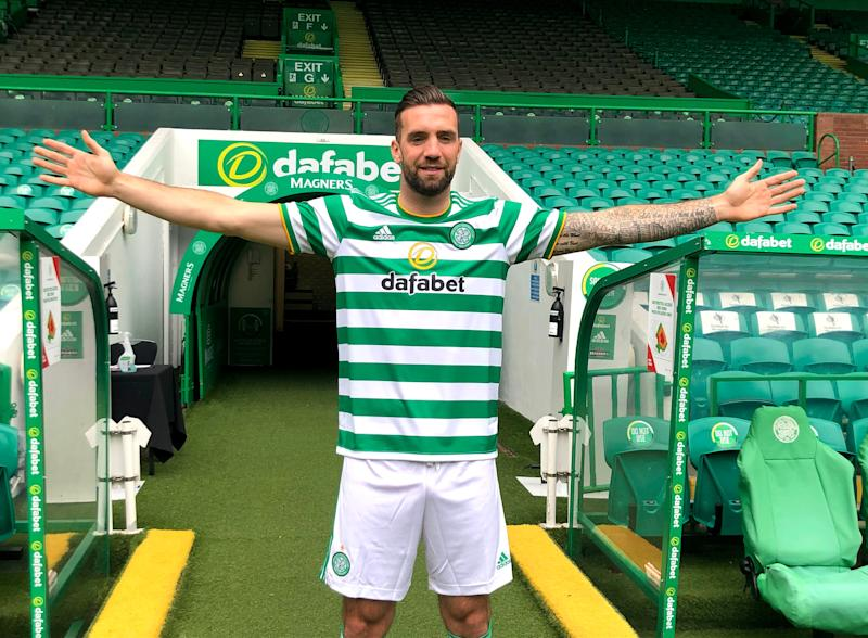 Shane Duffy poses at Celtic Park after moving to Glasgow from Brighton (PA)