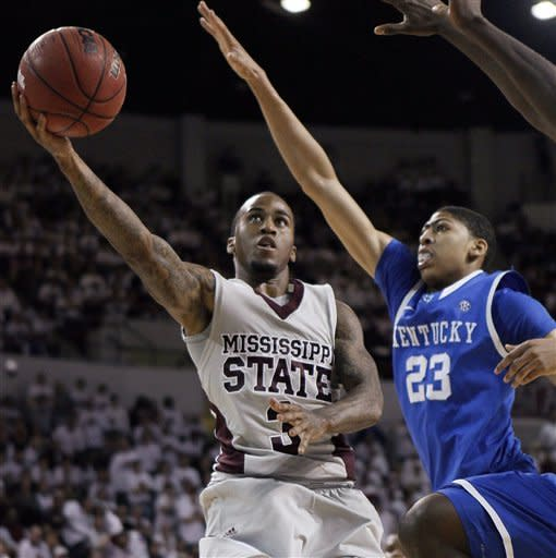 Mississippi State guard Dee Bost (3) shoots as Kentucky forward Anthony Davis (23) defends during the second half of an NCAA college basketball game in Starkville, Miss., Tuesday, Feb. 21, 2012. No. 1 Kentucky won 73-64. (AP Photo/Rogelio V. Solis)