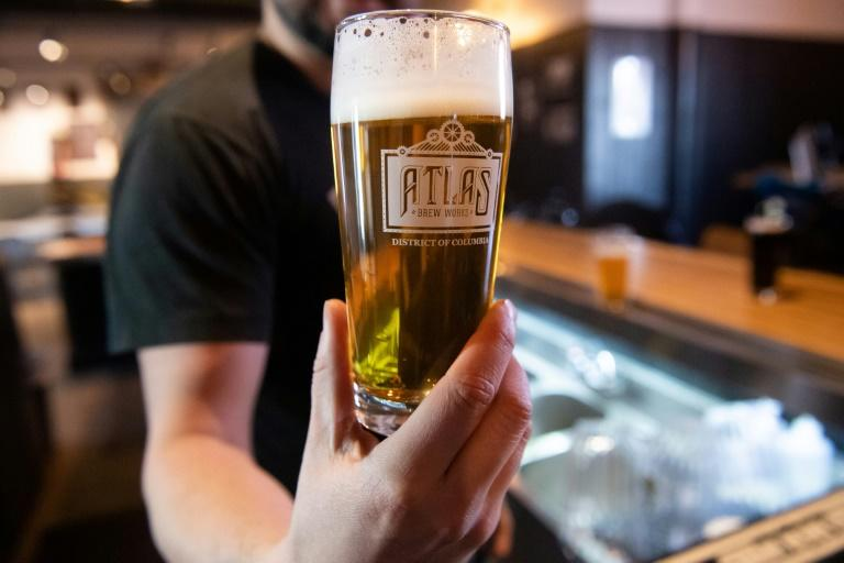 A bartender at Atlas Brew Works in Washington serves up an IPA on tap (AFP Photo/SAUL LOEB)