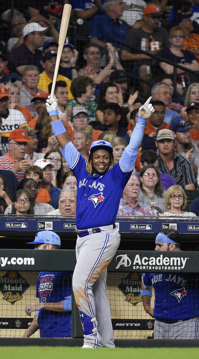 Toronto Blue Jays' Vladimir Guerrero Jr. celebrates Freddy Galvis's three-run home run off Houston Astros relief pitcher Cionel Perez during the sixth inning of a baseball game, Sunday, June 16, 2019, in Houston. (AP Photo/Eric Christian Smith)
