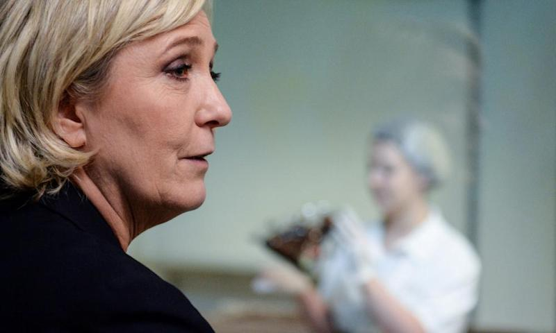 Marine Le Pen visits a chocolate maker in Chalezeule, eastern France.
