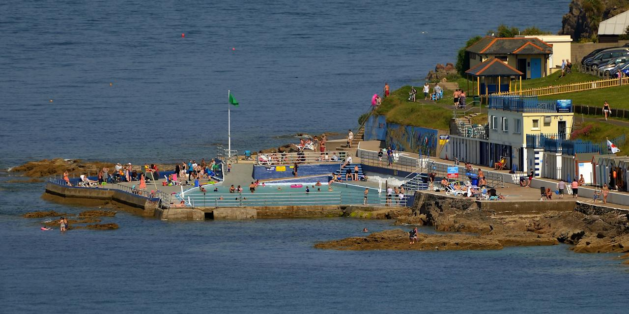 """Situated on England's Devon coast, the <a href=""""http://shoalstonepool.com/"""" target=""""_blank"""">Shoalstone Pool</a> is a 173-foot-long seawater swimming pool perched upon the Brixham seafront. Unlike Australia's abundant ocean-fed pools, this is one of the few left in England and has become a bit of an Art Deco darling. Built into a natural rock, Shoalstone has been used for bathing since the Victorian era (1830s–1900) and continues to be a favorite for summering in the English Riviera."""