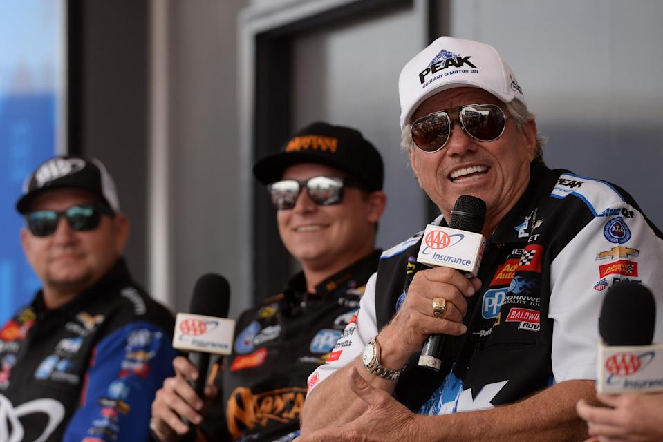 John Force (R) and his three other drivers won't race at all in NHRA until 2021. (Photo by Michael Allio/Icon Sportswire via Getty Images)