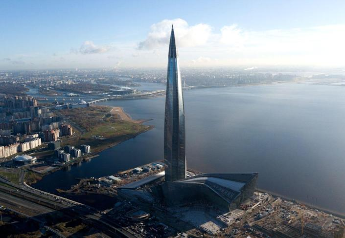 """<p><strong>Location:</strong> St. Petersburg, Russia</p><p><strong>Height:</strong> 1,516 feet</p><p><strong>Completion date</strong>: 2019</p><p>Spiking straight into the sky, the distinct design of the Lakhta Center on the outskirts of St. Petersburg offer a """"lonely spire in a horizontal landscape"""" that will serve as the centerpiece to a growing neighborhood around it that includes plenty of open space for pedestrians. The building includes thermal insulation via a double-glazed façade to combat the summertime heat and an ice formation control system for winter weather.</p>"""