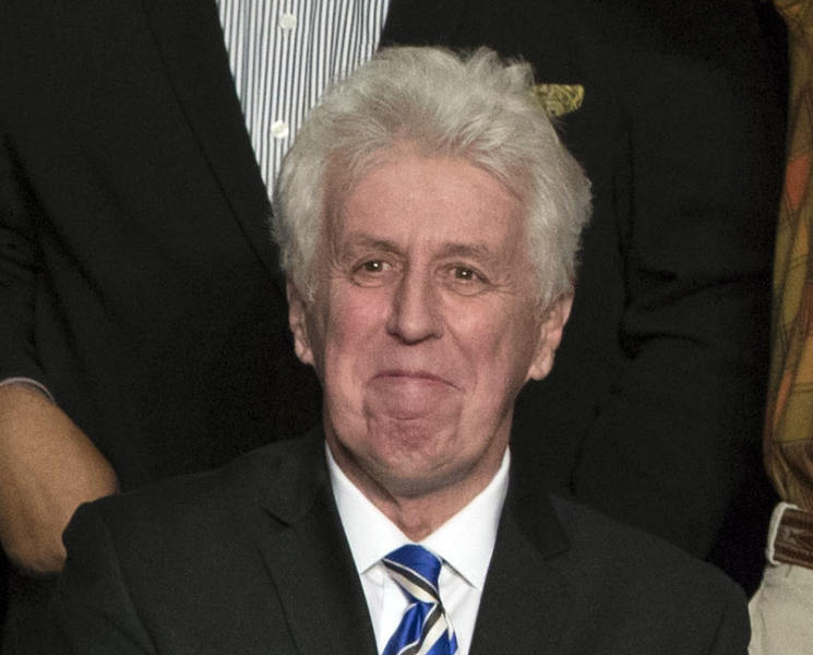 """<p> FILE - In this Dec. 15, 2016, photo, CNN commentator Jeffrey Lord, appears at a rally for President-elect Donald Trump in Hershey, Pa. Lord made a comparison of Trump to Martin Luther King Jr., on CNN's morning """"New Day."""" He is one of a handful of pro-Trump commentators that CNN hired during the last election. (AP Photo/Matt Rourke, File) </p>"""