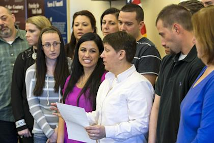 Lesa Strachan, in white shirt, reads a statement after the conviction of Aaron Hernandez. (AP)