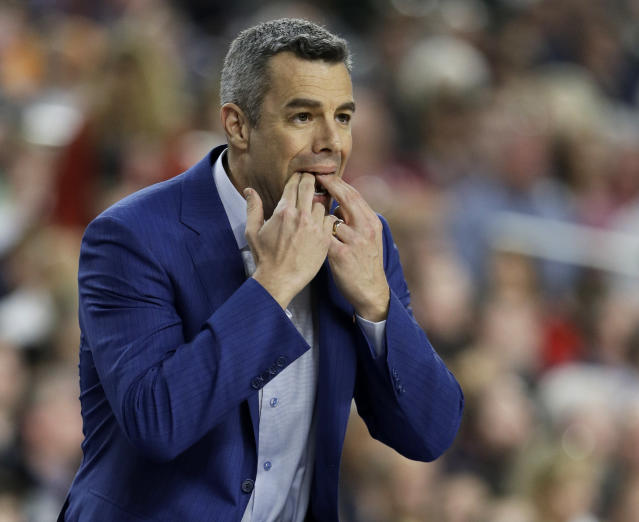 Virginia head coach Tony Bennett signals to his team during the first half against Auburn in the semifinals of the Final Four NCAA college basketball tournament, Saturday, April 6, 2019, in Minneapolis. (AP Photo/David J. Phillip)