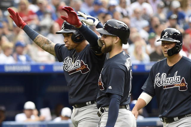 Atlanta Braves' Johan Camargo, left, celebrates with teammates after hitting a grand slam off Toronto Blue Jays starting pitcher Jaime Garcia during the second inning of a baseball game Tuesday, June 19, 2018, in Toronto. (Nathan Denette/The Canadian Press via AP)