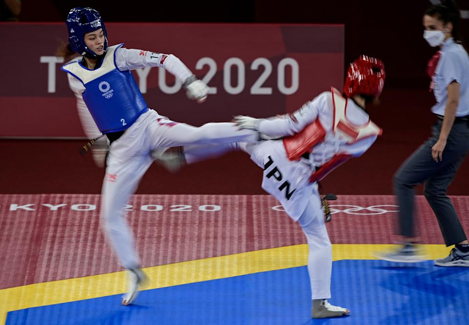 Taiwan's Su Po-Ya (Blue) and Japan's Miyu Yamada (red) compete in the taekwondo women's -49kg elimination round bout during the Tokyo 2020 Olympic Games at the Makuhari Messe Hall in Tokyo on July 24, 2021. / AFP / Javier SORIANO