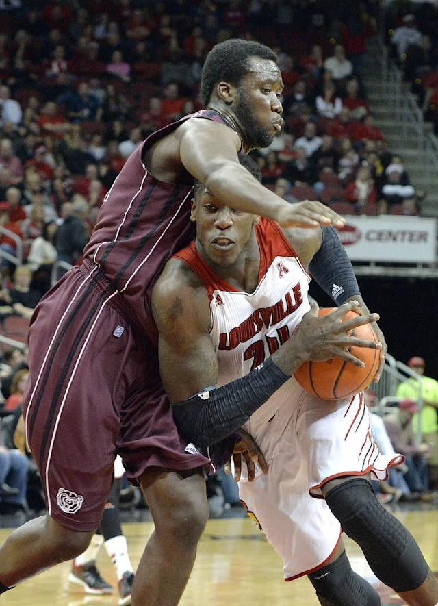 Louisville's Montrezl Harrell, right, attempts to drive under the defense of Missouri State's Emmanuel Addo during the second half of an NCAA college basketball game Tuesday, Dec. 17, 2013, in Louisville, Ky. Louisville won 90-60. (AP Photo/Timothy D. Easley)