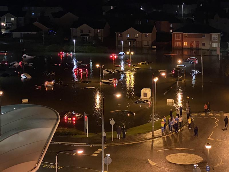 Hospital workers finishing their shifts were shocked to find their cars submerged in water when the staff car park flooded - following severe thunderstorms. See SWNS story SWSCcars. Cars parked at the Victoria Hospital in Kirkcaldy, Fife, were pictured floating away after Scotland was battered by torrential rain. The vehicles are said to have suffered extensive damage after being carried away by gallons of water. NHS Fife chief executive, Carol Potter, said the hospital itself was still operating as normal but that car parks A & B were out of action as a result.