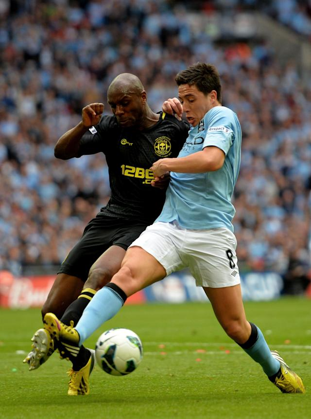 LONDON, ENGLAND - MAY 11: Samir Nasri of Manchester City battles with Emmerson Boyce Wigan Athletic (L) during the FA Cup with Budweiser Final between Manchester City and Wigan Athletic at Wembley Stadium on May 11, 2013 in London, England. (Photo by Shaun Botterill/Getty Images)