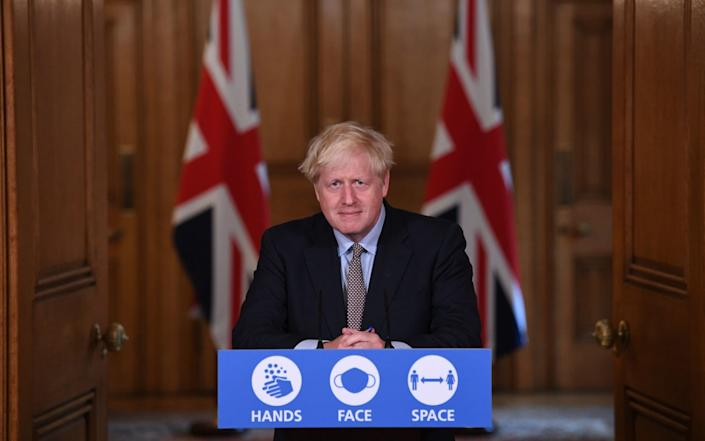 Prime Minister Boris Johnson during a virtual press conference at Downing Street, London, following the announcement that the legal limit on social gatherings is set to be reduced from 30 people to six - Stefan Rousseau/PA