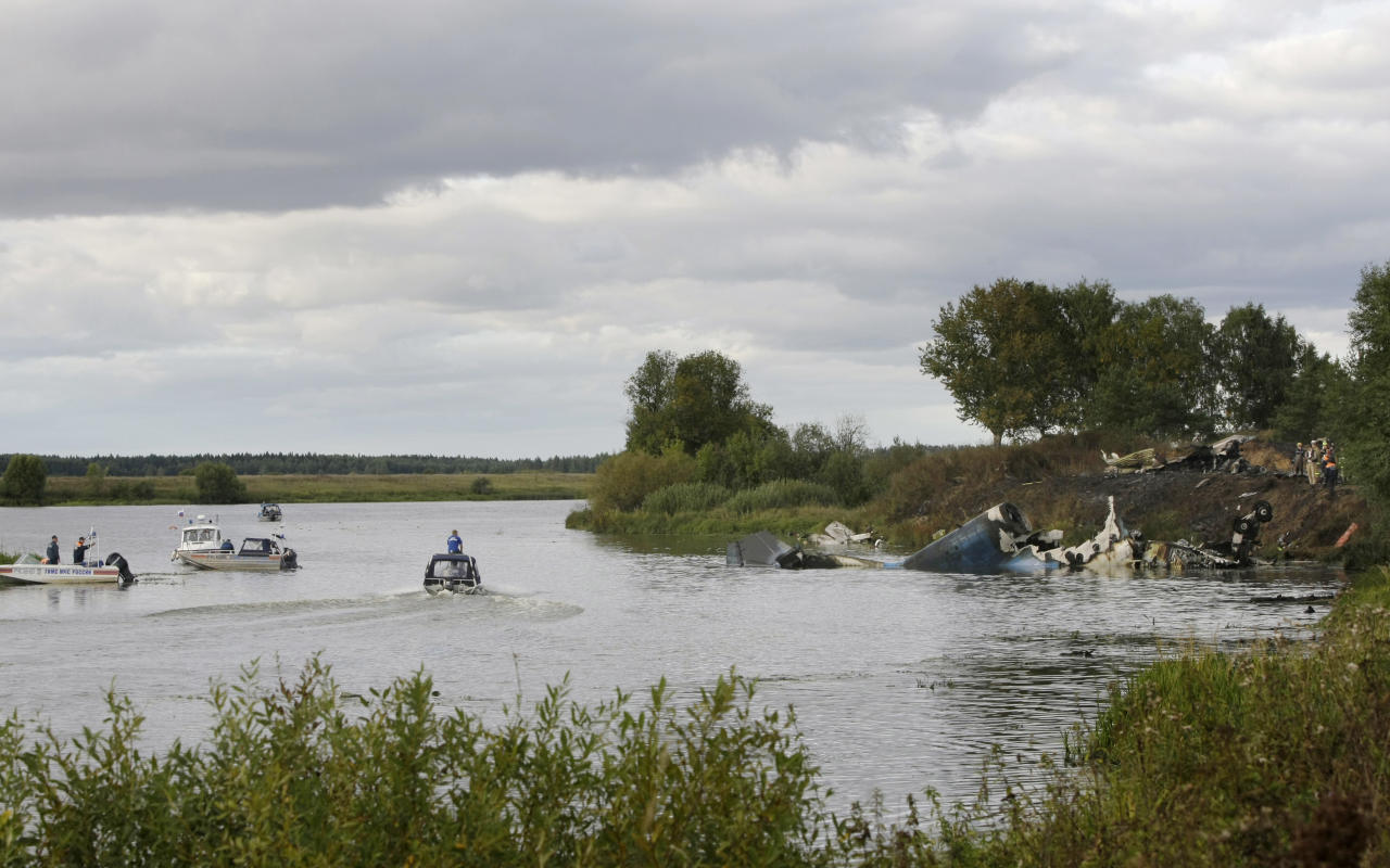 Rescuers work at the crash site of Russian Yak-42 jet near the city of Yaroslavl, on the Volga River about 150 miles (240 kilometers) northeast of Moscow, Russia, Wednesday, Sept. 7, 2011. The Yak-42 jet carrying a top ice hockey team crashed while taking off Wednesday in western Russia. The Russian Emergency Situations Ministry said the plane was carrying the Lokomotiv ice hockey team from Yaroslavl.(AP Photo/Misha Japaridze)