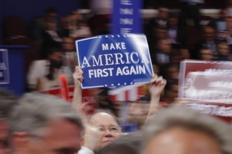 A delegate waves a sign on the floor during the third session of the Republican National Convention in Cleveland