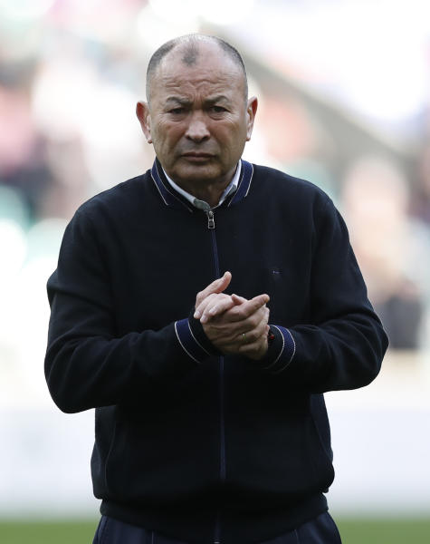 England's head coach Eddie Jones watches as his team prepares for the Six Nations international rugby union match between England and Ireland at Twickenham stadium in London, Sunday, Feb. 23, 2020. (AP Photo/Alastair Grant)
