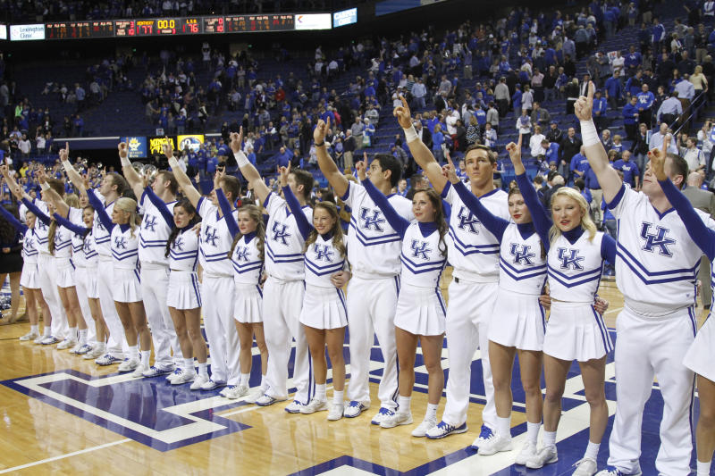 Kentucky cheerleaders perform during an NCAA college basketball game between Kentucky and LSU, Saturday, Feb. 22, 2014, in Lexington, Ky. Kentucky won 77-76. (AP Photo/James Crisp)