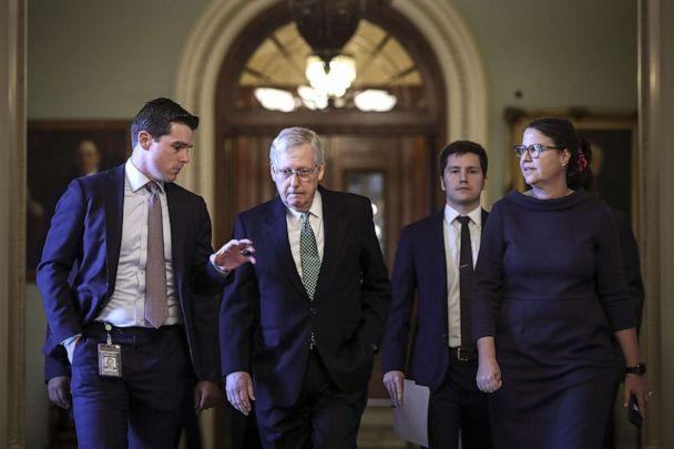 PHOTO: A reporter asks questions as Senate Majority Leader Mitch McConnell (R-KY) leaves the Senate floor and walks to his office at the Capitol, Jan. 8, 2020, in Washington, D.C. (Drew Angerer/Getty Images)