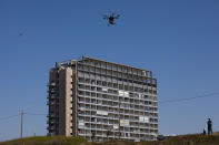 A drone carries goods as part of the National Drone Initiative test operation and demonstration for journalists, in Tel Aviv, Israel, Monday, Oct. 11, 2021. This was the third demonstration in Israel of the drone pilot program set to deliver goods and medicine across Israel. (AP Photo/Oded Balilty)