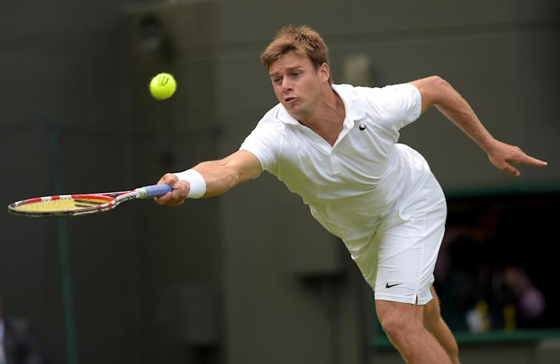 A file photo shows US player Ryan Harrison during the men's singles first round match at Wimbledon, June 23, 2014
