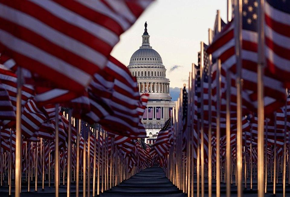 """The """"Field of flags"""" is seen on the National Mall in front of the U.S. Capitol building ahead of inauguration ceremonies for President-elect Joe Biden in Washington DC. 20 January 20, 2021."""