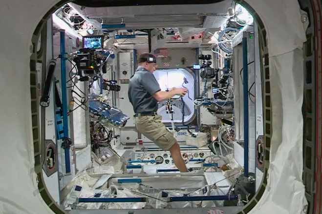 Chris Cassidy prepares the hatch door through to the ISS (NASA TV)