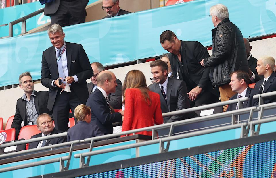 LONDON, ENGLAND - JUNE 29: Former England International, David Beckham interacts with Prince William, President of the Football Association prior to the UEFA Euro 2020 Championship Round of 16 match between England and Germany at Wembley Stadium on June 29, 2021 in London, England. (Photo by Catherine Ivill/Getty Images)