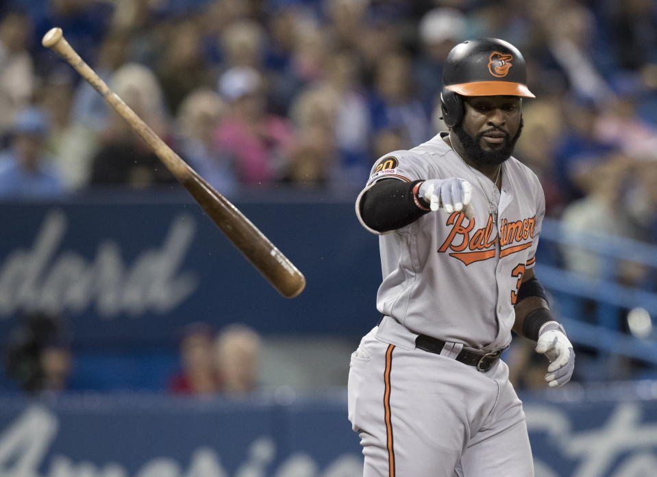 Baltimore Orioles' Dwight Smith Jr. tosses his bat after being hit by a pitch during the sixth inning of the team's baseball game against the Toronto Blue Jays on Tuesday, Sept. 24, 2019, in Toronto. (Fred Thornhill/The Canadian Press via AP)