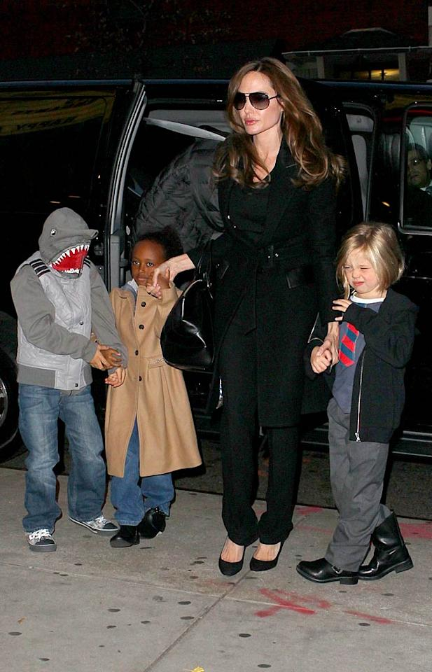 """Mega-mom Angelina Jolie took half her brood -- (L-R) 8-year-old Pax, who hid behind a shark hood;  6-year-old Zahara; and 5-year-old Shiloh -- to see """"The Muppets"""" movie in New York City on Saturday night. See? Brad and Angie don't spend <i>every</i> Saturday night at a red carpet event or A-list party! (12/3/2011)"""