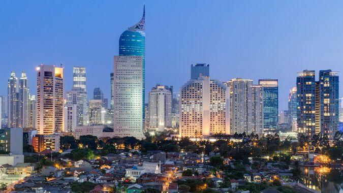 Jakarta downtown skyline with high-rise buildings at sunset.