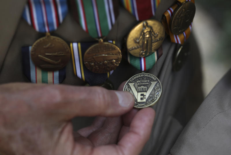 Donald Cobb, 95, of the US Navy, shows his medals during an interview with the Associated Press Friday, Aug.23, 2019 in Paris. Cobb, who was aboard the USS Murphy during the battles of Normandy, Southern France, North Africa and in the Mediterranean sea, was part of a group of World War II veterans taking part in commemorations of the 75th anniversary of the Allied operation to liberate Paris from Nazi occupation. (AP Photo/Daniel Cole)