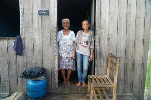 Raimunda Vianam (L), 88, and Maria Conceicao Braga, 76, pose in the town of Carauari where residents fear the reach and spread of the coronavirus COVID-19 pandemic in the Amazon, Brazil on March 16, 2020