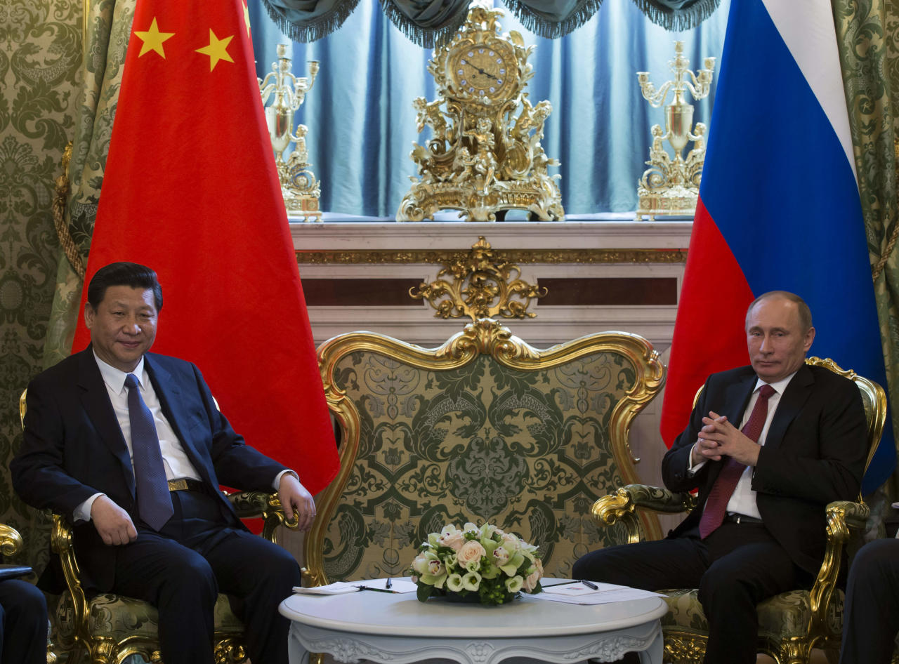 Russian President Vladimir Putin, right, and Chinese President Xi Jinping meet in the Kremlin in Moscow, Russia, Friday, March 22, 2013. Russia is Xi Jinping's first foreign destination as China's president. Xi's talks with Putin on Friday are set to focus on oil and gas as China seeks to secure new energy resources to fuel its growing economy. (AP Photo/Alexander Zemlianichenko, Pool)