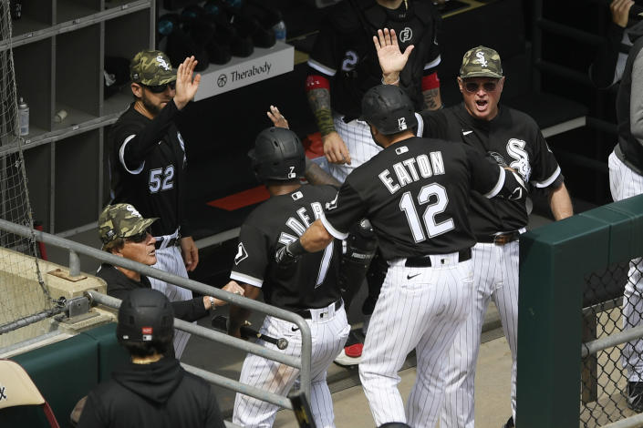 Chicago White Sox's Adam Eaton (12) and Tim Anderson (7) celebrate at the dugout with manager Tony LaRussa left, after Eaton hit a two-run home run during the fifth inning of a baseball game against the Kansas City Royals, Sunday, May 16, 2021, in Chicago. (AP Photo/Paul Beaty)