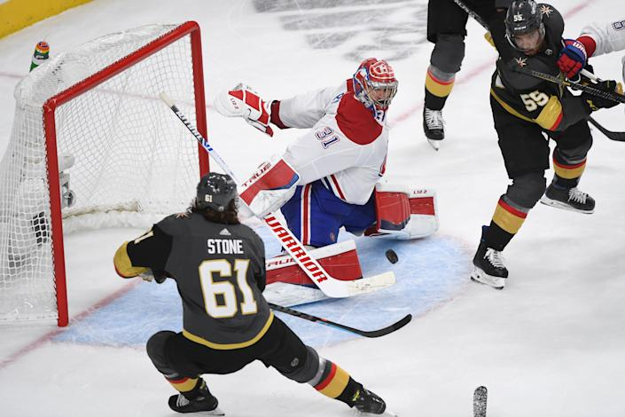 LAS VEGAS, NEVADA - JUNE 16: Carey Price #31 of the Montreal Canadiens stops a shot by Mark Stone #61 of the Vegas Golden Knights as Keegan Kolesar #55 of the Vegas Golden Knights watches in the third period in Game Two of the Stanley Cup Semifinals during the 2021 Stanley Cup Playoffs at T-Mobile Arena on June 16, 2021 in Las Vegas, Nevada. The Canadiens defeated the Golden Knights 3-2. (Photo by Sam Morris/Getty Images)