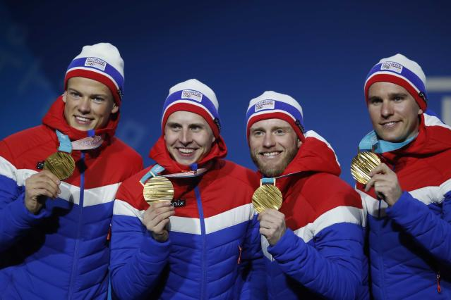 Medals Ceremony - Cross-Country Skiing - Pyeongchang 2018 Winter Olympics - Men's 4x10 km Relay - Medals Plaza - Pyeongchang, South Korea - February 18, 2018 - Gold medalists Didirk Toenseth, Johnsrud Martin Sundby, Simen Hegstad Kreuger and Johannes Hoesflot Klaebo of Norway on the podium. REUTERS/Kim Hong-Ji