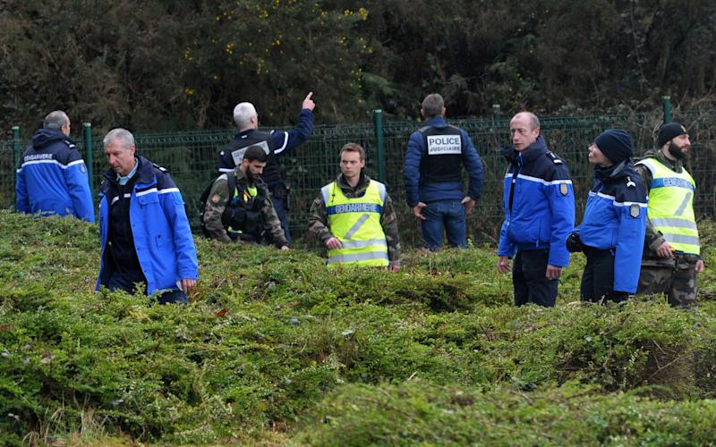 French Gendarmes and a member of the French judiciary police take part in search operations looking for the Troadec family, missing since February 16 - Credit: AFP