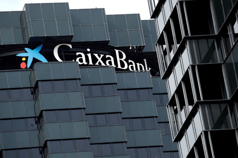 FILE PHOTO: CaixaBank's logo is seen on top of the company's headquarters in Barcelona