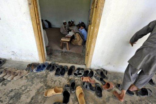 Pakistani students recite the Koran at a Islamic madrassa near the final hideout of Osama bin Laden in Abbottabad. Bin Laden fathered four children as he hid out in Pakistan after the 9/11 attacks, his youngest wife told interrogators, according to a police report seen by AFP on Friday