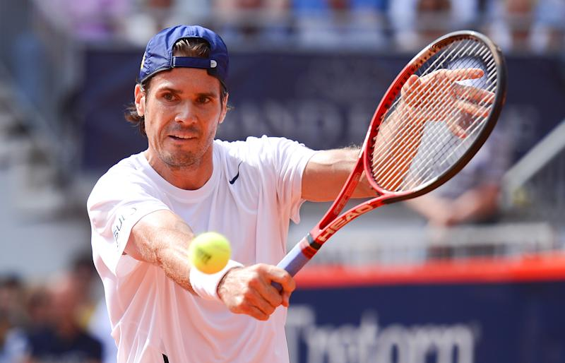 Germany's Tommy Haas returns a ball to Blaz Kavcic from Slovenia during their tennis match at the German Open ATP tournament in Hamburg, Germany, Wednesday July 17, 2017. (AP Photo/dpa,Axel Heimken)