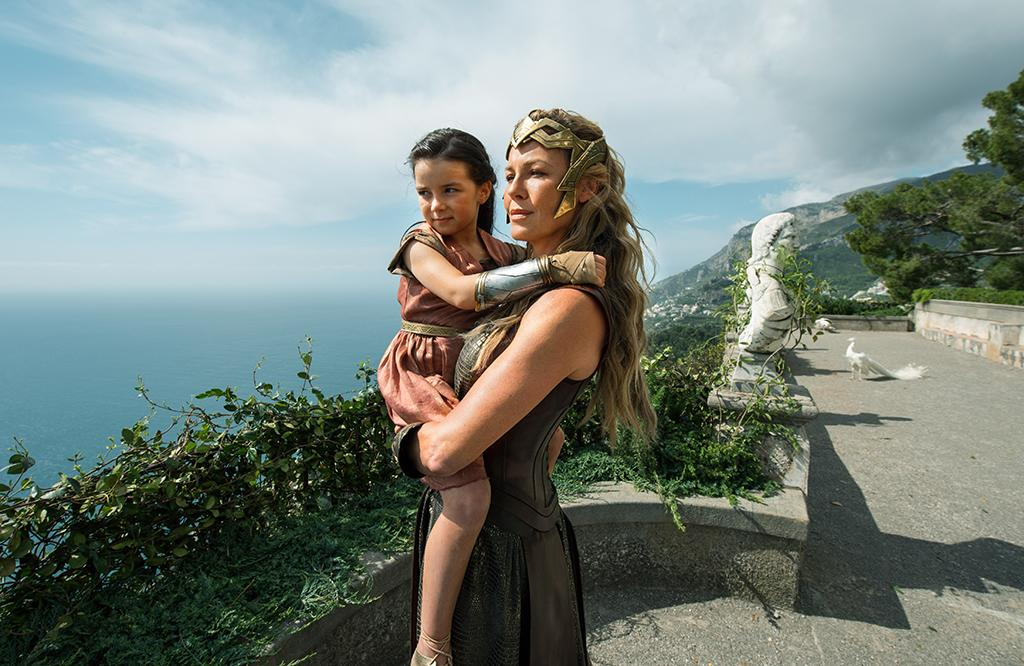 <p>The young princess (Lilly Aspell) and her royal mother (Connie Nielsen) take in the view from the parapets of Themyscira, a.k.a. Paradise Island. (Photo: Warner Bros.) </p>