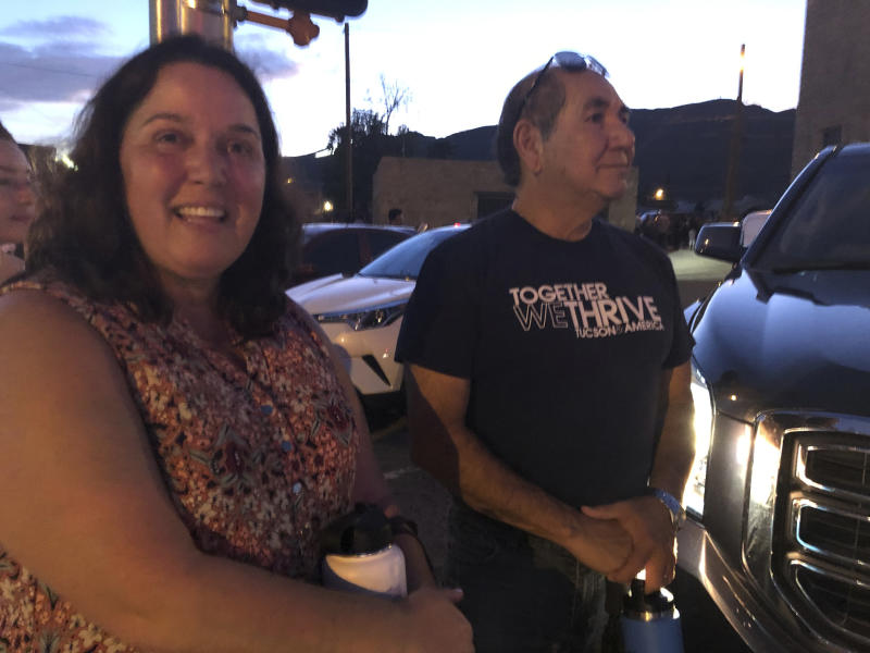Angelique Tadeo, 52, left, and her husband, Paul, both of Tucson, Ariz., stand in line with thousands of others Friday, Aug. 16, 2019, to pay respects to Margie Reckard, 63, who was killed by a gunman who opened fire at a Walmart in El Paso, Tex., earlier this month. Thousand of strangers from El Paso and around the country came to honor this weekend Reckard. Her long-time companion, Antonio Basco, says he felt so alone planning her funeral, that he invited the world to join him in remembering his companion of 22 years. (AP Photo/Russell Contreras)
