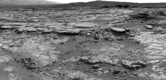 """The sinuous rock feature in the lower center of this mosaic of images recorded by the NASA Mars rover Curiosity is called """"Snake River."""" Image taken Dec. 20, 2012."""